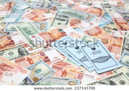 "MOSCOW, RUSSIA - DECEMBER 11: Bank books of Saving Bank of Russian Federation (SBRF) . Inscription on book in russian: ""Saving Bank of Russia"", ""savings book"". December 11, 2014 in Moscow - stock photo"