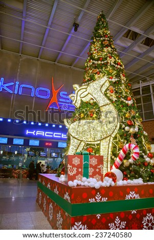 MOSCOW, RUSSIA - DECEMBER 04, 2014:Christmas decorations- glowing deer and tree at the cinema in a shopping centre - stock photo