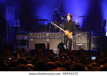 MOSCOW, RUSSIA - DECEMBER 14: Ex-beatle Sir Paul McCartney performs onstage at Olimpiyskiy Arena December 14, 2011 in Moscow, Russia. - stock photo