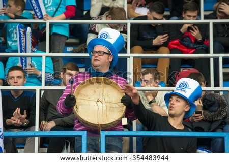 MOSCOW, RUSSIA - DECEMBER 2, 2015: Fans of Dynamo Moscow during the game on women's Rissian volleyball Championship game Dynamo (MSC) vs Dynamo (KZN) at the Luzhniki stadium in Moscow, Russia - stock photo