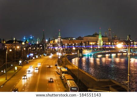 MOSCOW, RUSSIA - DECEMBER 09, 2006: Few cars go by illuminated embankment of  Moscow river with view on Kremlin