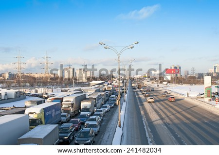 MOSCOW, RUSSIA - DECEMBER 26, 2014: Full highway in winter at the Moscow Automobile Ring Road (MKAD).  - stock photo