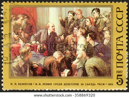 """MOSCOW, RUSSIA - DECEMBER, 2015: post stamp printed in the USSR shows Lenin snd Delegates at the 3rd Congress of the Soviet Communist League, series """"The 117th Birth Anniversary of Lenin"""",  circa 1987 - stock photo"""