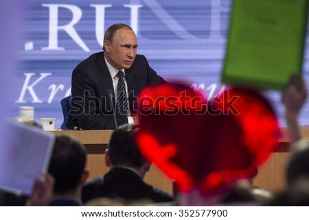 MOSCOW, RUSSIA - DECEMBER 17, 2015: Russian President Vladimir Putin at his 11th annual media question-and-answer session in the World Trade Center on Krasnaya Presnya in Moscow, Russia - stock photo