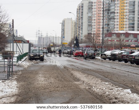 Moscow, Russia, December 12, 2015: Slushy road with vehicle tracks after hevy snowfall during winter. Very wet and slippery