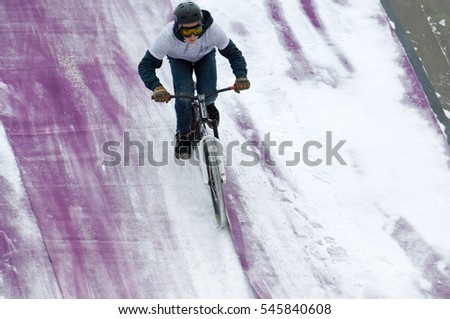 MOSCOW, RUSSIA - DECEMBER 10, 2016: Unidentified rider landing on bike trampoline on Winter game season opening event on December 10, 2016
