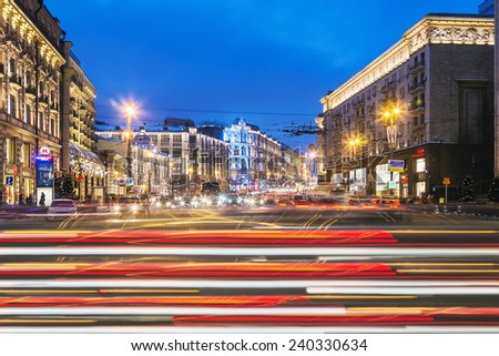 Moscow, Russia - December 27, 2014: view of Tverskaya street from Manezhnaya square in winter evening. Tverskaya Street is main street and existed as early as the 12th century in Moscow, Russia. - stock photo