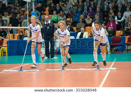 MOSCOW, RUSSIA - DECEMBER 2, 2015: Young athletes clean field on women's Rissian volleyball Championship game Dynamo (MSC) vs Dynamo (KZN) at the Luzhniki stadium in Moscow, Russia - stock photo