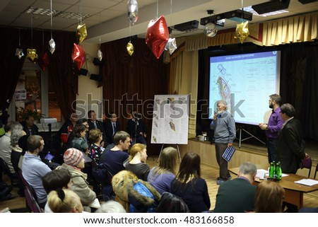 MOSCOW, RUSSIA - 4 FEB, 2015: Residents are discussing planning district Bogorodskoe in hall with plan on screen.