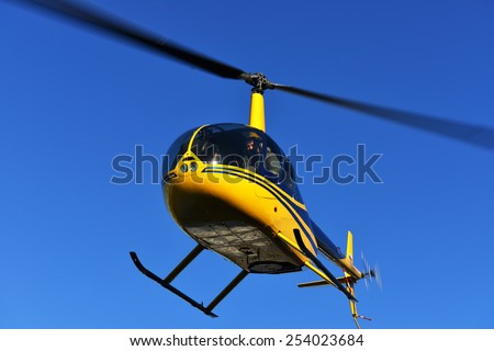MOSCOW, RUSSIA - FEB 18, 2015:Robinson R44 is four-seat light helicopter produced by Robinson Helicopter Company since 1992. One of world's most popular helicopters with twin blades and single engine - stock photo