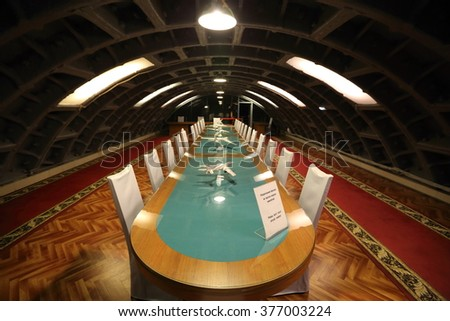 MOSCOW, RUSSIA - FEBRUARY 08, 2016: A long wooden table in the meeting room in the bomb shelter - stock photo