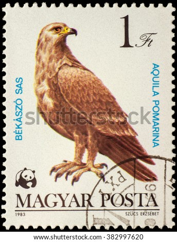 "MOSCOW, RUSSIA - FEBRUARY 28, 2016: A stamp printed in Hungary shows Lesser Spotted eagle (Aquila pomarina), series ""World Wildlife Fund - Birds of Prey"", circa 1983"