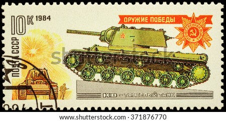 "MOSCOW, RUSSIA - FEBRUARY 03, 2016: A stamp printed in USSR (Russia) shows World War II russian heavy tank KV (Klim Voroshilov) and Order of the Patriotic War, series ""World 