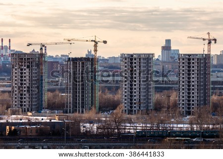 MOSCOW, RUSSIA - FEBRUARY 27, 2016. Aerial view of Nagatinskaya bottom-land and the district Nagatino and ZIL. In the foreground the construction of the four residental apartments buildings.