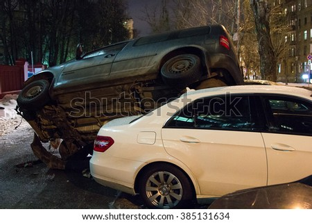 MOSCOW, RUSSIA - February 26, 2016: car parked on the roof of the other two - stock photo