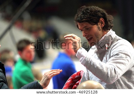MOSCOW, RUSSIA - FEBRUARY 14: Italy's Aldo Montano compete at the 2010 RFF Moscow Saber World Fencing Tournament, February 14, 2010 in Moscow, Russia. - stock photo