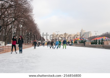 MOSCOW, RUSSIA - February 23, 2015: People at Skating rink in The Central Park of Culture and Rest named after Maxim Gorky in Moscow. Park is a largest in Moscow was  established in 1928. - stock photo