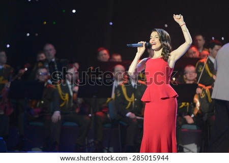 """MOSCOW, RUSSIA - FEBRUARY 27, 2014: Sati Casanova - Russian singer, former soloist of the Russian women's group """"Factory"""", TV presenter. Concert in the State Kremlin Palace ceremony """"Shield and rose"""". - stock photo"""