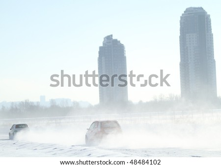 """MOSCOW, RUSSIA - FEBRUARY 23: 21st traditional """"Race Stars""""Za rulyom"""" on the ice road in Tushino (racing drivers: David Coulthard, Vitaly Petrov, Firdaus Kabirov), February 23, 2010 in Moscow, Russia. - stock photo"""