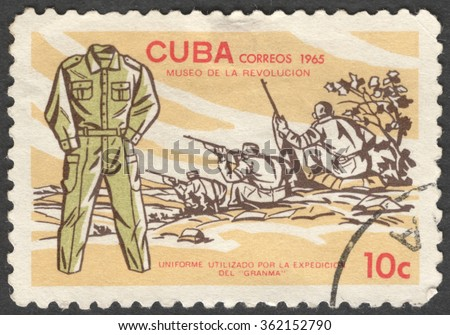 """MOSCOW, RUSSIA - JANUARY, 2015: a post stamp printed in CUBA shows a soldier's uniform of Granma, the series """"Museum of the Revolution"""", circa 1965 - stock photo"""