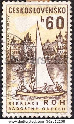 "MOSCOW, RUSSIA - JANUARY, 2016: a post stamp printed in CZECHOSLOVAKIA shows Zinkovy Sanatorium and Sailing Dinghy, the series ""Czech Workers' Social Facilities"", circa 1962 - stock photo"