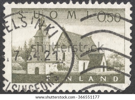 "MOSCOW, RUSSIA - JANUARY, 2016: a post stamp printed in FINLAND shows an old church in Lammi, the series ""Different daily stamps in large format"", circa 1963"