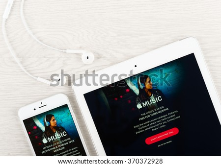 Moscow, Russia - January 30, 2016: Apple music application on the display of iphone and ipad gadgets. Apple Music is a music streaming service developed by Apple Inc. - stock photo