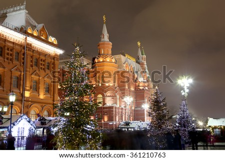 MOSCOW, RUSSIA- JANUARY 07, 2016:Christmas holidays illumination and State Historical Museum at night, near the Kremlin  in Moscow, Russia.Historical Museum-- inscription in Russian on the building