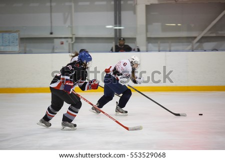 "Moscow, Russia - January, 08, 2017: Female amateur hockey league LHL-77. Game between female hockey team ""Spartanki"" and female hockey team ""Valkiry""."