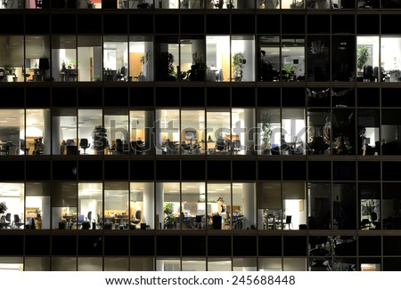 MOSCOW, RUSSIA - JANUARY 16, 2015: People work in an office buildings in Moscow city district, Moscow, January 16, 2015.  - stock photo