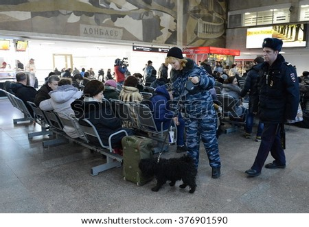 MOSCOW, RUSSIA - JANUARY 20, 2014: Police officers inspect the waiting room Paveletsky station of capital service dog.