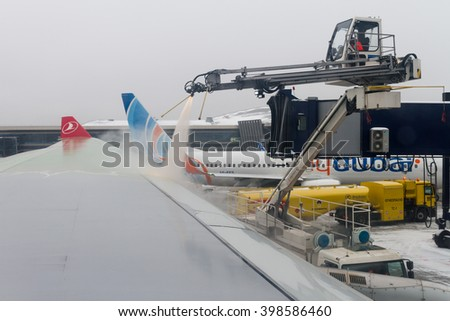 MOSCOW, RUSSIA - JANUARY 12, 2016: Turkish Airlines Airbus 330 de-icing at Vnukovo Airport, Russia. - stock photo