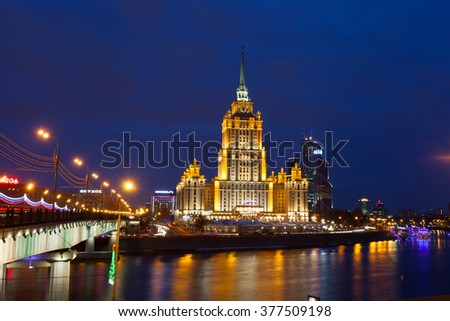 MOSCOW, RUSSIA - JANUARY 19, 2015: Ukraine hotel (Radisson Royal Hotel) in night illumination. Radisson Royal Hotel - the five-star hotel located in the center of Moscow, in one of Stalin skyscrapers. - stock photo