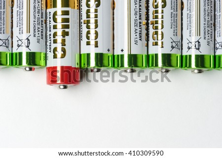 Moscow, Russia - January 04, 2016: Used alkaline batteries AA size format with green top and one with red top lying in a row. Studio shot - stock photo