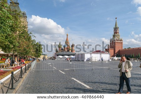 Moscow, Russia - July 07, 2016: A man talking on a cell phone, standing in Red Square near the Kremlin