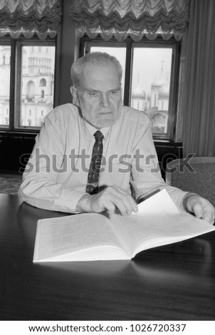 Moscow, Russia - July 23, 1993: Alexey Vladimirovich Yablokov, environmental adviser to russian President Boris Yeltsin in his Kremlin office. Scan of black and white negative film.