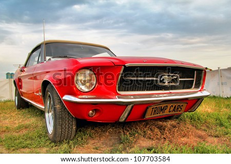 MOSCOW, RUSSIA - JULY 6: American muscle car Ford Mustang exhibited at the annual International Motor show Autoexotica on July 6, 2012 in Moscow, Russia. - stock photo