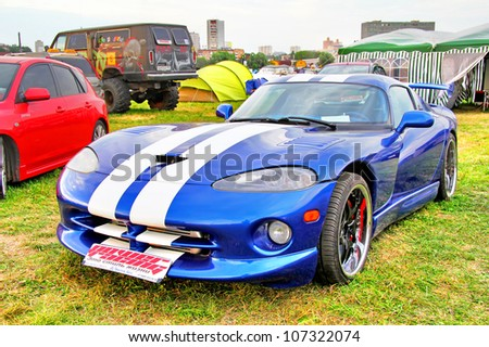 MOSCOW, RUSSIA - JULY 6: American sports car Dodge Viper exhibited at the annual International Motor show Autoexotica on July 6, 2012 in Moscow, Russia. - stock photo