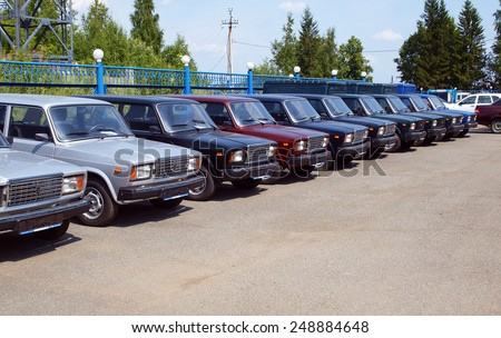 MOSCOW. RUSSIA - JULY 17, 2012: New russian cars are lined up. Auto Service is the official dealer of Auto VAZ - stock photo