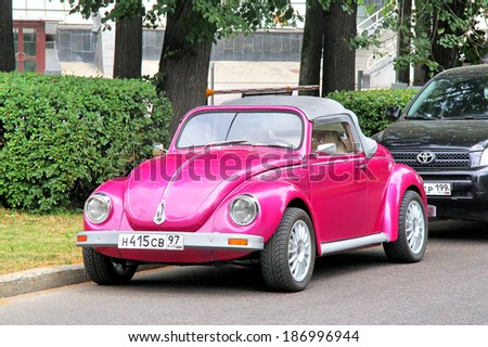 MOSCOW, RUSSIA - JULY 7, 2012: Pink Volkswagen Beetle custom car at the city street. - stock photo