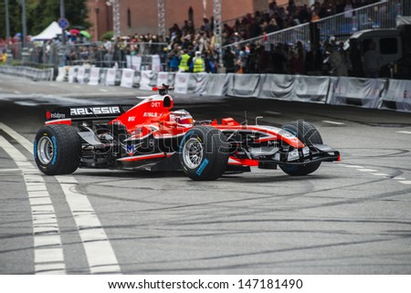 MOSCOW, RUSSIA - JULY 21: Professional Formula 1 Marussia driver Max Chilton in Moscow City Racing Circle, Moscow on 21 July 2013 - stock photo