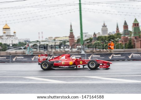 MOSCOW, RUSSIA - JULY 21: Professional Formula 1 Scuderia Ferrari driver Kamui Kobayashi  in Moscow City Racing Circle, Moscow on 21 July 2013,  - stock photo