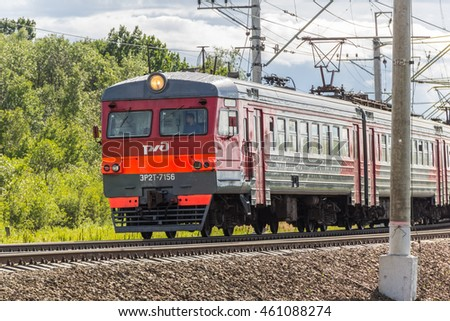 Moscow, Russia - July 05, 2106: Railway in the forest with pillars and train come closer