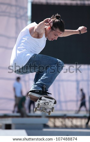 MOSCOW, RUSSIA - JULY 8: Ravshan Baimuradov in skateboarding competition during Adrenalin Games in Moscow, Russia on July 8, 2012