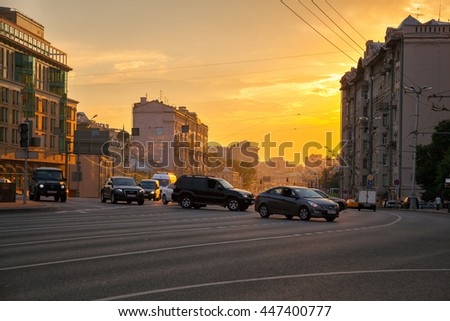 MOSCOW, RUSSIA - JULY 3, 2016: Sadovaya Spasskaya street, movement of cars on the garden ring (Sadovoe ring). City skyline at sunset.