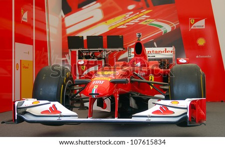 MOSCOW, RUSSIA - JULY 14: Scuderia Ferrari sport car at Moscow City Racing. Formula 1 teams show in historical city center of Moscow. Taken on July 14, 2012 in Moscow, Russia. - stock photo