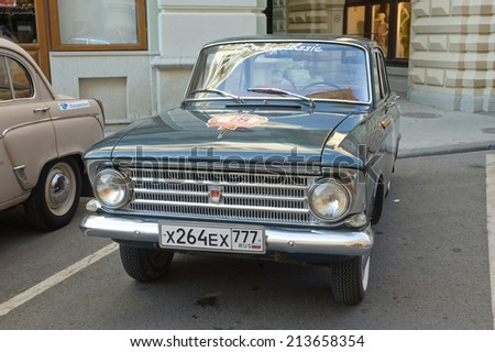 MOSCOW, RUSSIA - July 26, 2014: Soviet car Moskvich-408 on retro rally Gorkyclassic, GUM, Moscow, front view