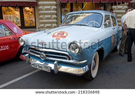 "MOSCOW, RUSSIA - July 26, 2014:Soviet retro two-tone car ""Volga"" GAZ-21 first series on retro rally Gorkyclassic about Gum, Moscow, front view"