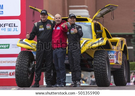 MOSCOW, RUSSIA - JULY 7, 2016: Sports car and crew are on the podium during the opening of the Silk Way rally Dakar series on the Red square near the Kremlin