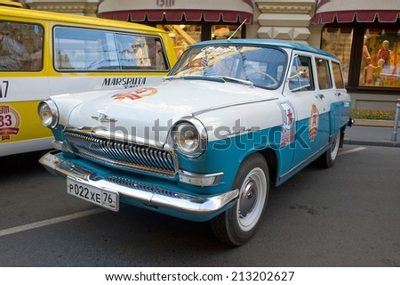 MOSCOW, RUSSIA - July 26, 2014: Two-tone car Volga GAZ-22 on retro rally Gorkyclassic near Gum Department store, Moscow, front view